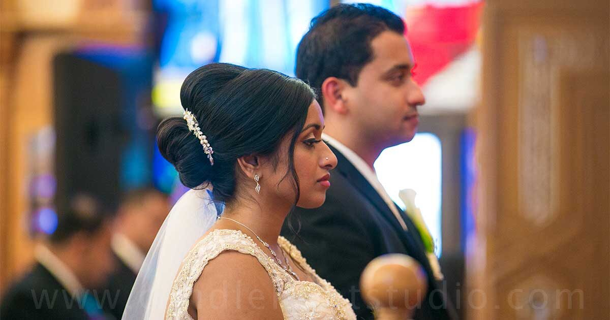 The bride and groom are dressed in the traditional Kerala wedding attire